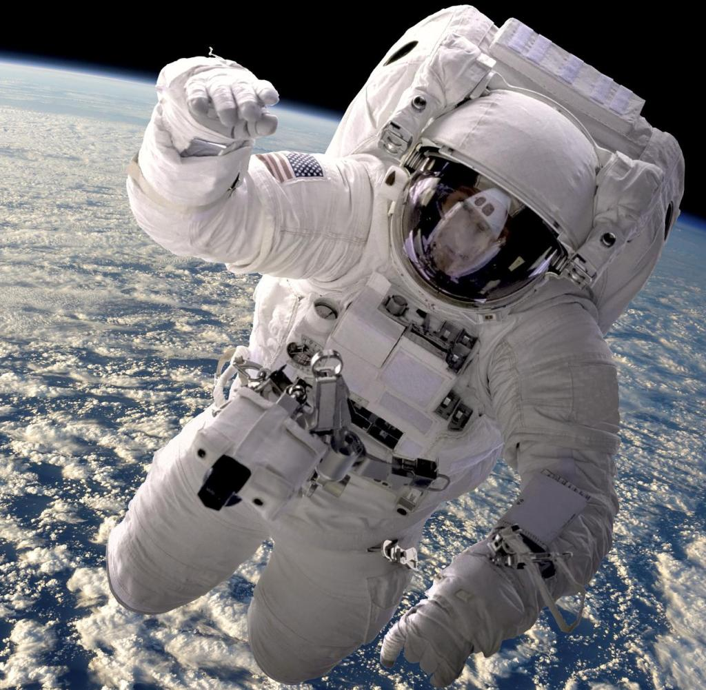 Artist's opinion of an astronaut floating in space.  The cloud-covered earth is below.