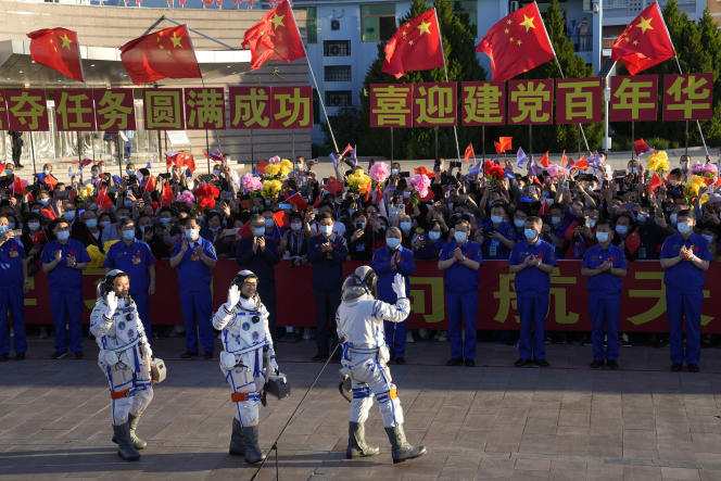Chinese astronauts Tang Hongbo, Liu Booming and Ni Heisheng before the Long-March 2F rocket takes off in Juan on June 17, 2021.